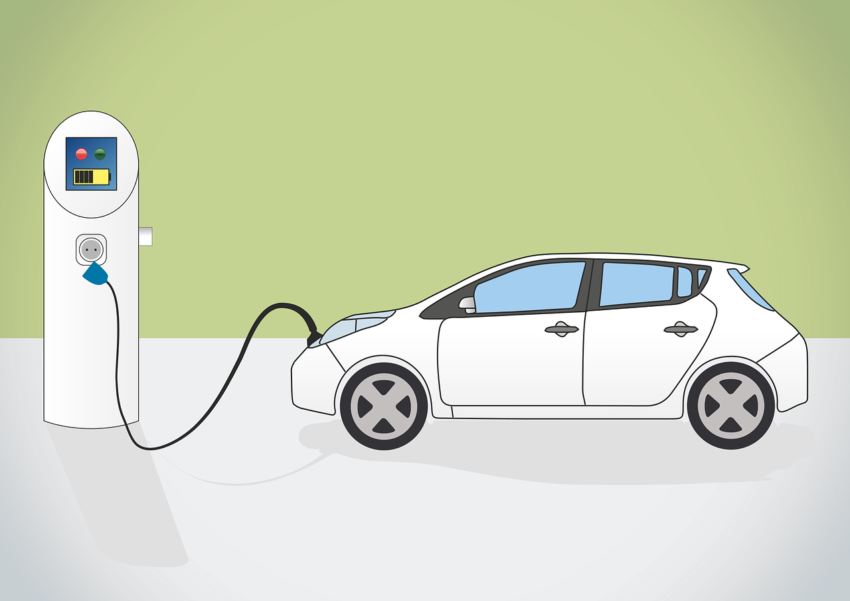 Ein Elektroauto wird an einer Stromquelle aufgeladen.